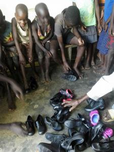 Giving out shoes 2